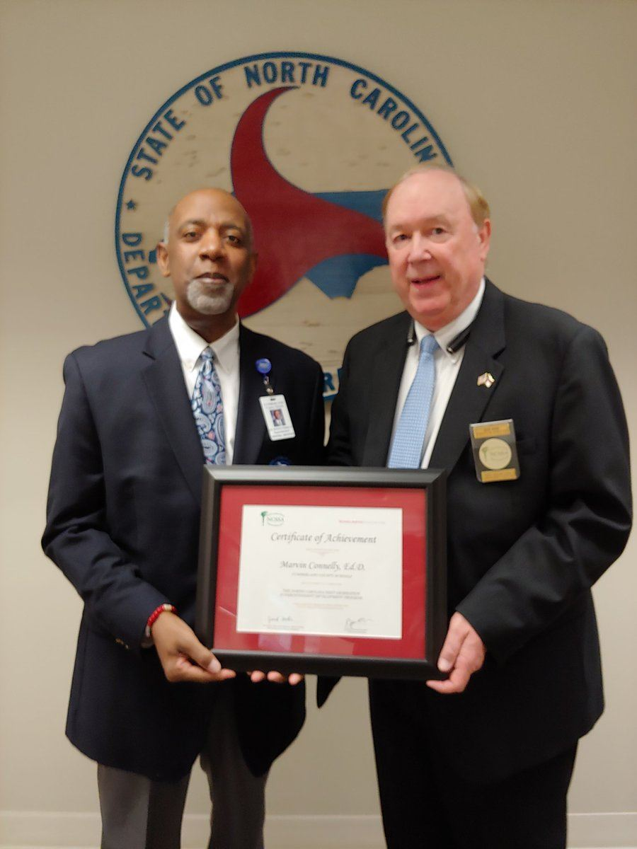 CCS Superintendent Dr. Marvin Connelly (right) receives and Award from Jack Hoke (Left)