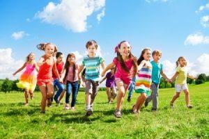 Children running in the grass