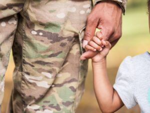 Military Officer Holding a Child's Hand