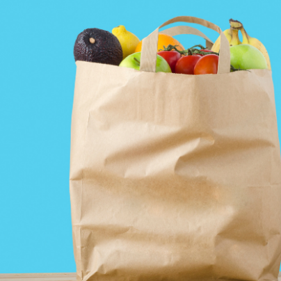 bag of groceries on counter with blue background